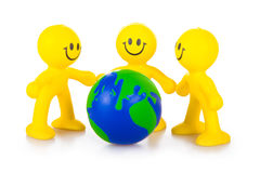 Three persons have control over globe. Royalty Free Stock Photography