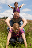 Three persons are making a leapfrog jump Stock Photography