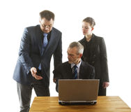Three persons in an office. Royalty Free Stock Photography
