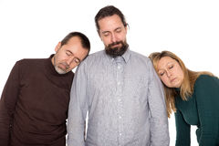 Three persons sleeping standing up Royalty Free Stock Image