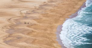 Walk on the beach in Portugal the city of Nazare. Stock Image