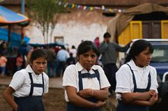 Three Peruvian schoolgirls. Royalty Free Stock Image
