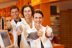 Three pharmacists holding thumbs up Stock Photography