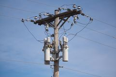 Three Phase DIstribution Reclosers. Photo of a three phase distribution line with reclosers Royalty Free Stock Photo