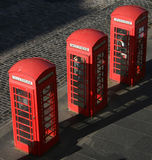 Three phone boxes. Three red British phone boxes Stock Image