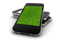 Three phone with grass Royalty Free Stock Photos
