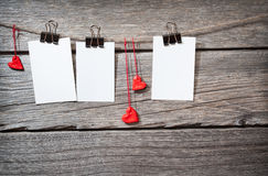 Three photo paper attach to rope with clothes Stock Photo