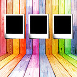 Three photo slide in a colorful wooden room Royalty Free Stock Image