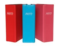 Three photograph albums  pink, red and blue color. Royalty Free Stock Image