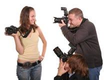 Three photographers Stock Images