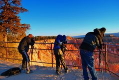 Three photographers prepare for sunrise shoot over bryce canyon national park royalty free stock photos