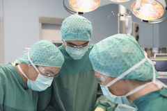 Three Physicians In Surgery Royalty Free Stock Image