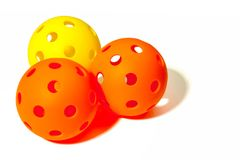 Free Three Pickleballs - 2 Orange And 1 Yellow Together On A White Background. Royalty Free Stock Image - 113825876