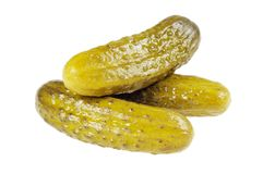 Three pickled  cucumbers.  Gherkins. Stock Photos