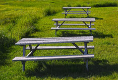 Three Picnic Wooden Tables Grass Stock Photography
