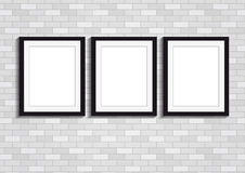 Three picture frames on a wall Royalty Free Stock Image