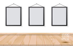 Three picture frames on wooden floor and white wall Royalty Free Stock Photography