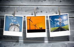 Three pictures of different themes hung with clothespins. On wooden boards background Royalty Free Stock Photo