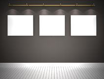 Three pictures on the grey wall. Background Stock Photography