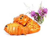 Three pie in the form of fish, pig, and a flower Stock Image