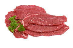 Three pieces of beef with parsley, isolated. Three pieces of beef with  a spring parsley, isolated Stock Image