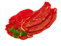 Three pieces of beef with a sprig of parsley. Isolated Royalty Free Stock Photography