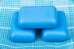 Three pieces of blue soap on towel Royalty Free Stock Images