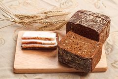 Three pieces of brackish bacon on rye bread Royalty Free Stock Photography