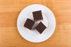 Three pieces of cakes with chocolate in white glass plate Royalty Free Stock Images