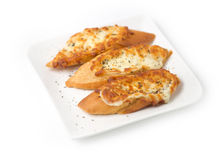 Three pieces of garlic bread topped with cheese Royalty Free Stock Images
