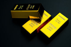 Three pieces of gold bar on black Royalty Free Stock Image