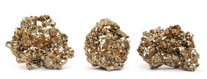 Three pieces of golden Pyrite crystals. Isolated on a white background Stock Photos