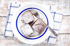 Three pieces of homemade chocolate brownie dessert on a plate Royalty Free Stock Images