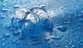 Three pieces of ice on a blue water drop background. Like a predator, grinning stock image