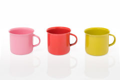 Three pieces of metal mug coating color include path on a white Royalty Free Stock Photography