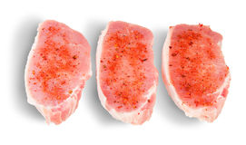 Three Pieces Of Raw Pork With Spices Royalty Free Stock Photos