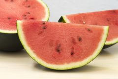 Slice of watermelon. Three pieces of red watermelon, close-up of a slice stock photos