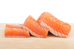 Three pieces of salmon. On cutting board Royalty Free Stock Image