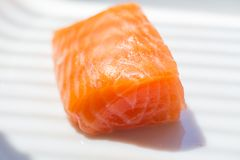Three pieces of salmon. On cutting board Stock Photography