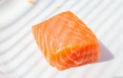 Three pieces of salmon. On cutting board Stock Photo