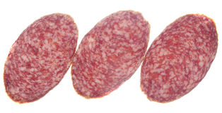 Three pieces of sausage. On a white background. In isolation Stock Photo