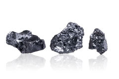 Three pieces of a small Anthracite coal,  on white Stock Photos