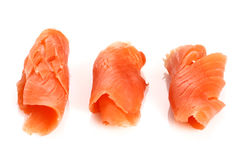 Three pieces of smoked salmon on white Stock Photography
