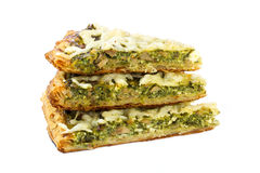 Three pieces of traditional greek spinach pie with goat cheese Royalty Free Stock Photos