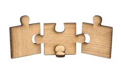 Three pieces of wooden jigsaw are connected together isolated on white background. concept of connecting stock image