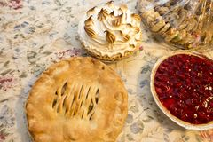 Holiday pies on the table ready for desert stock photos