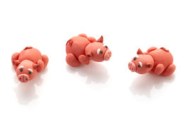 Three pig doll from clay Stock Photos