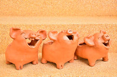 Three Pig statues laugh Royalty Free Stock Photography