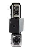 Three piled photo cameras Stock Image