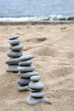 Three piles of balanced stones Royalty Free Stock Images